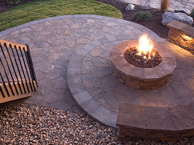 A propane outdoor fire pit on a patio