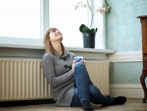 Women relaxing by a room heater