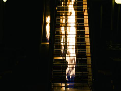 A close up of a propane patio heater