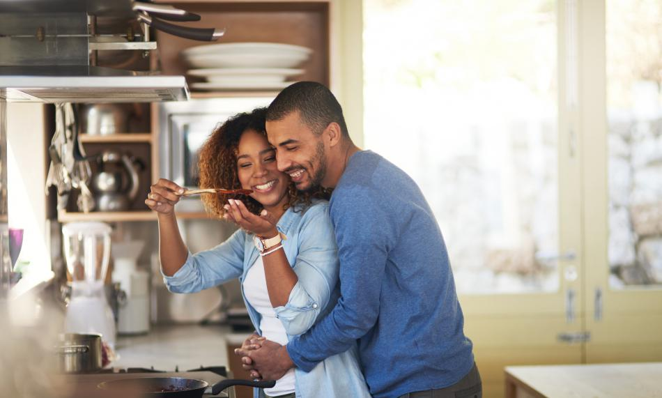 Couple having fun while cooking in the kitchen