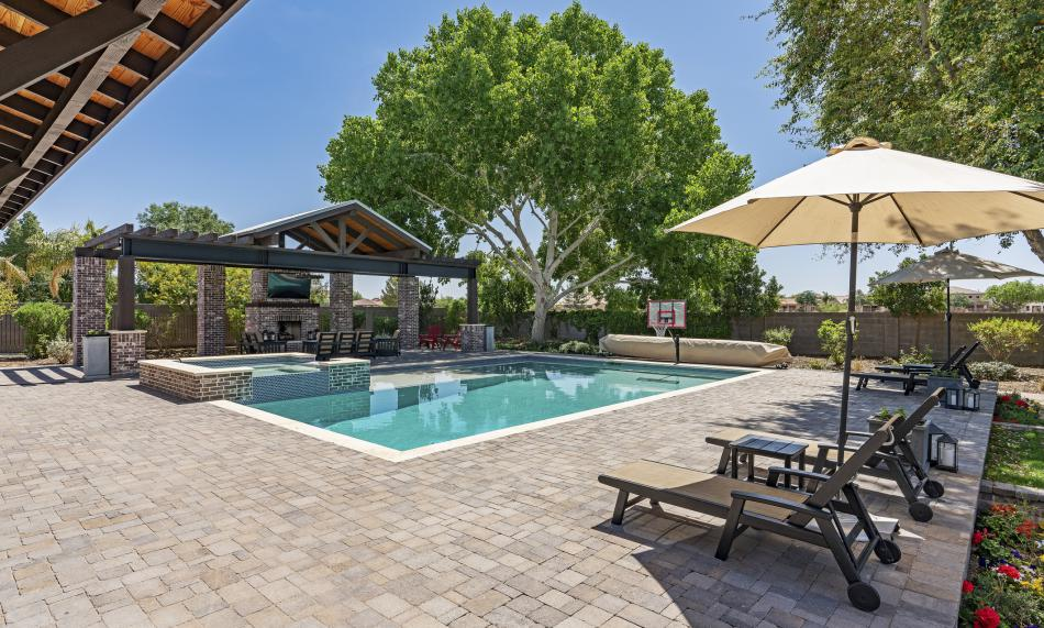 Luxurious backyard in-ground pool with patio