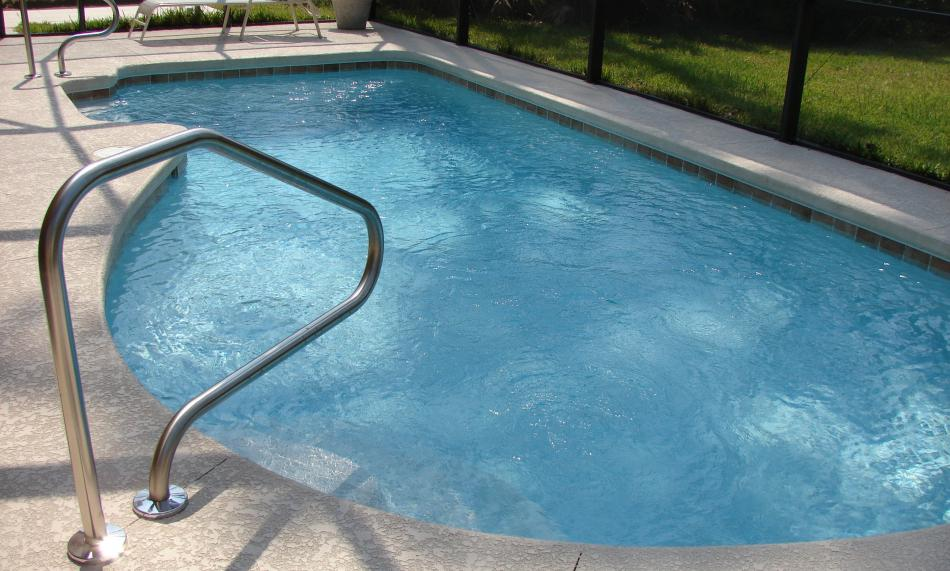 An enclosed in-ground pool