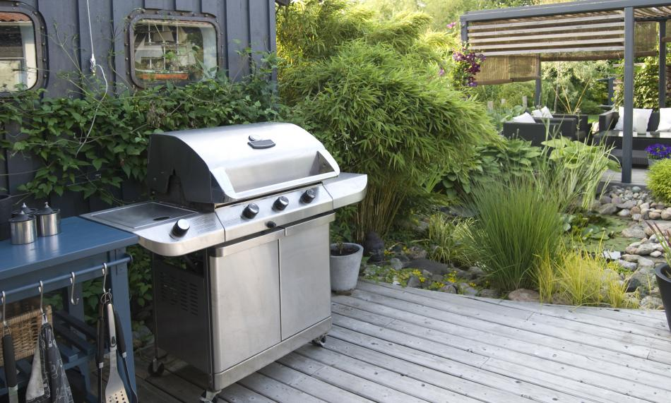 An outdoor grill in a backyard