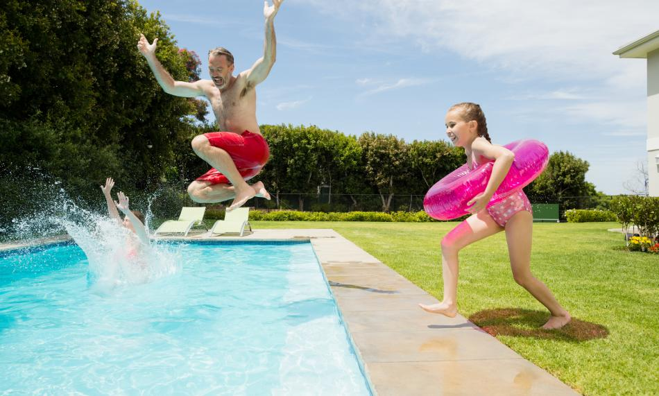 A backyard pool party with kids