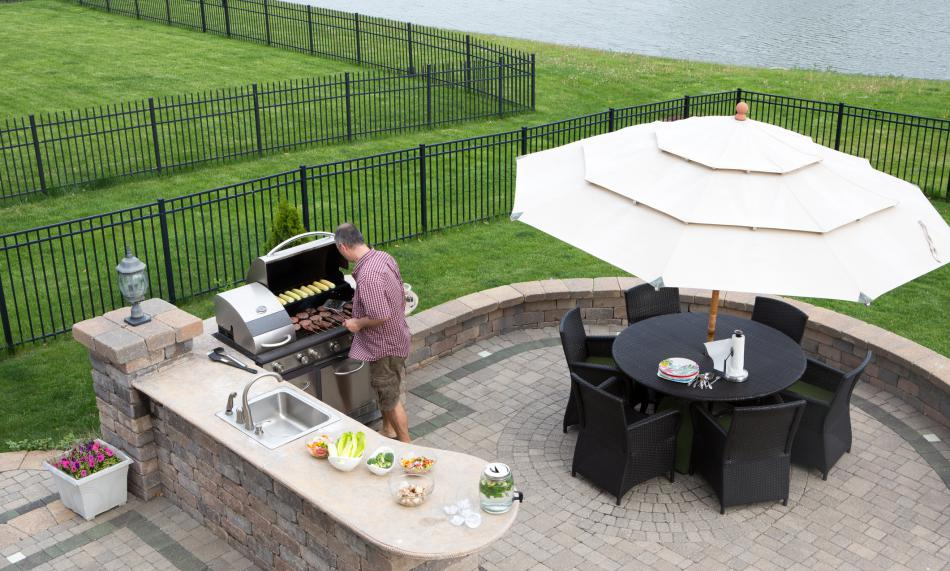 A man cooking on an outdoor propane grill