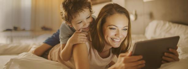 Mother and son reading a tablet.