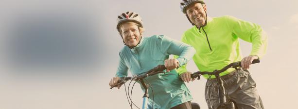 Elderly couple riding bikes.