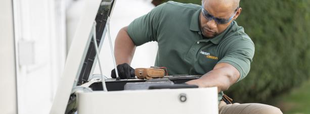 BantamWesson Technician working on a generator