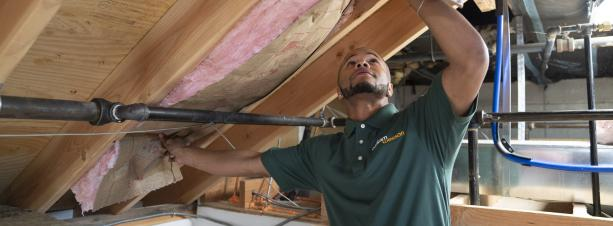 BantamWesson Technician installing home insulation