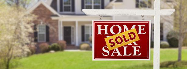 House with a sold sign in front
