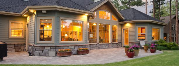 An exterior shot of a home showing beautiful home lighting