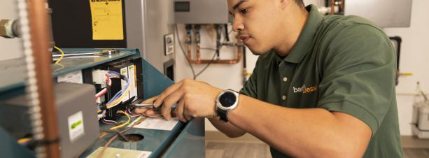 BantamWesson Technician working on a boiler