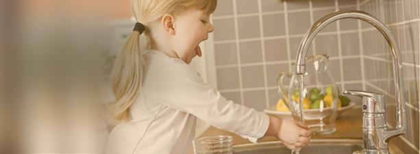 Little girl washing her hands.