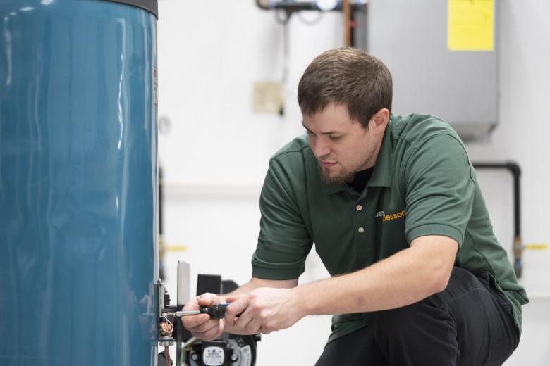 BantamWesson Plumber working on a hot water heater