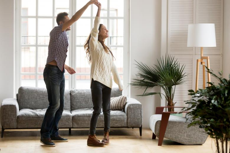 A couple dancing in the living room