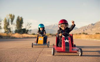 Kids racing in toy cars