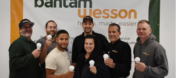 The Home Energy Audit team at BantamWesson holding LED bulbs