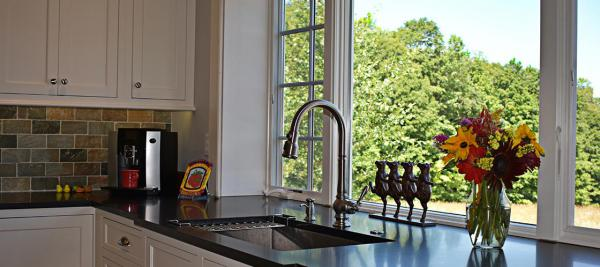 A kitchen sink and faucet that as recently upgraded in a kitchen renovation
