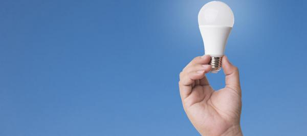 Hand holding an LED light bulb