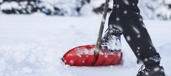 Man shoveling snow during a winter storm