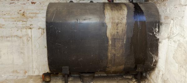 An old oil tank in a basement