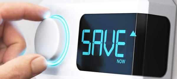"""A thermostat with the word """"save"""" on the display"""