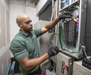BantamWesson Electrician working on an electrical panel
