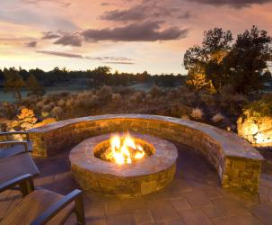 An outdoor firepit fueled by propane