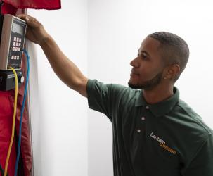 BantamWesson technician performing a blower door test