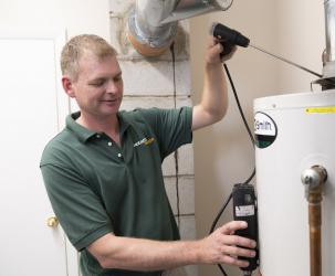 BantamWesson technician inspecting a water heater